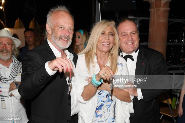 Michael Radford Mara Venier and Pascal Vicedomini attend 2018 Ischia Global Film Music Fest on July 16 2018 in Ischia Italy