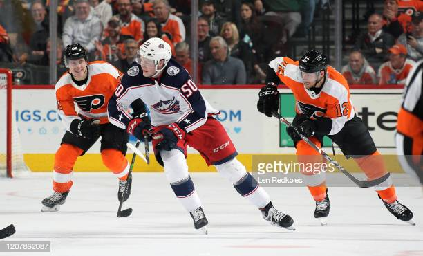 Michael Raffl and Nicloas AubeKubel of the Philadelphia Flyers skate against Eric Robinson of the Columbus Blue Jackets on February 18 2020 at the...