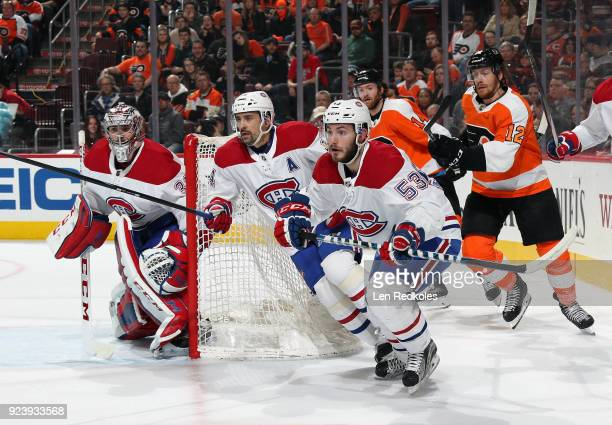 Michael Raffl and Sean Couturier of the Philadelphia Flyers in action against Carey Price Tomas Plekanec and Victor Mete of the Montreal Canadiens on...