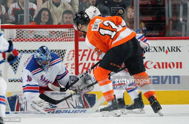 Michael Raffl of the Philadelphia Flyers attempts a scoring chance against Henrik Lundqvist and Neal Pionk of the New York Rangers on April 7 2018 at...