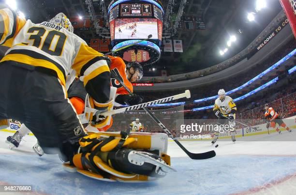 Michael Raffl of the Philadelphia Flyers attempts to deflect a shot on goal against Matt Murray of the Pittsburgh Penguins in Game Three of the...