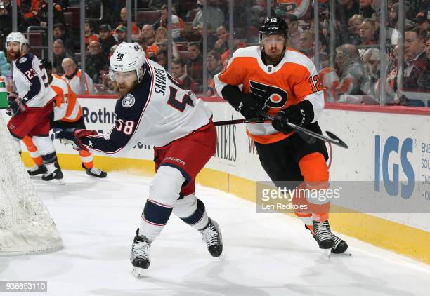 Michael Raffl of the Philadelphia Flyers battels against David Savard of the Columbus Blue Jackets on March 15 2018 at the Wells Fargo Center in...