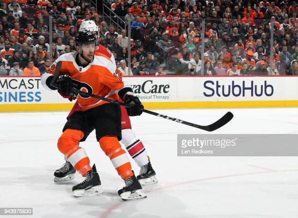 Michael Raffl of the Philadelphia Flyers battles against Noah Hanifin of the Carolina Hurricanes on April 5 2018 at the Wells Fargo Center in...