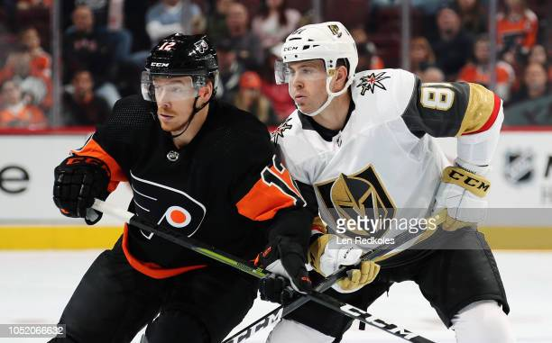 Michael Raffl of the Philadelphia Flyers battles for position with Jonathan Marchessault of the Vegas Golden Knights on October 13 2018 at the Wells...