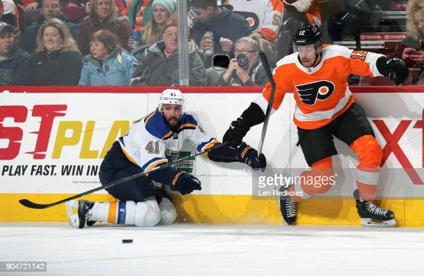 Michael Raffl of the Philadelphia Flyers battles for the puck along the boards against Robert Bortuzzo of the St Louis Blues on January 6 2018 at the...