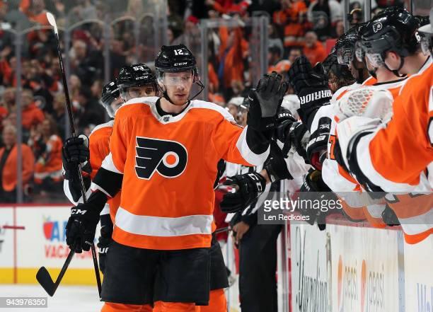Michael Raffl of the Philadelphia Flyers celebrates Claude Giroux's third period goal with teammates against the Carolina Hurricanes on April 5 2018...
