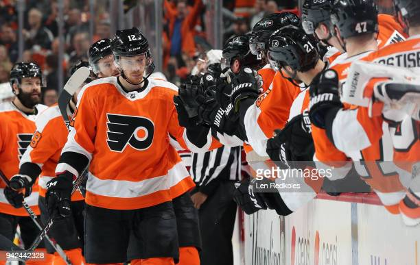 Michael Raffl of the Philadelphia Flyers celebrates his first period goal against the Carolina Hurricanes with his teammates on the bench on April 5...