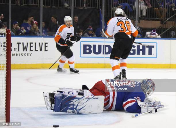 Michael Raffl of the Philadelphia Flyers celebrates his shorthanded goal at 1753 of the first period against Henrik Lundqvist of the New York Rangers...