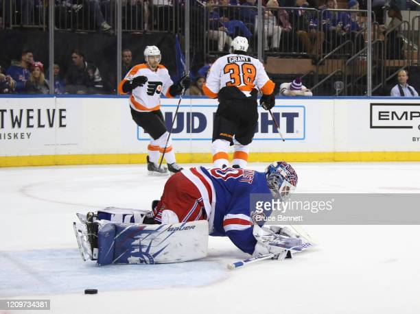 Michael Raffl of the Philadelphia Flyers celebrates his short-handed goal at 17:53 of the first period against Henrik Lundqvist of the New York...