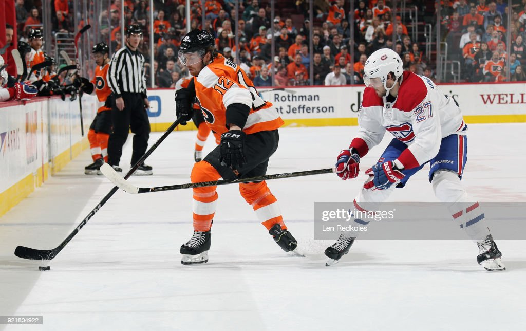 Michael Raffl #12 of the Philadelphia Flyers controls the puck while being pursued by Alex Galchenyuk #27 of the Montreal Canadiens on February 20, 2018 at the Wells Fargo Center in Philadelphia, Pennsylvania. The Flyers went on to defeat the Canadiens 3-2 in overtime.