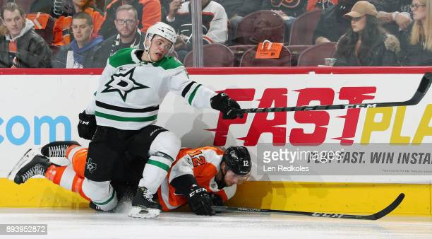 Michael Raffl of the Philadelphia Flyers falls to the ice after being checked by Julius Honka of the Dallas Stars on December 16 2017 at the Wells...