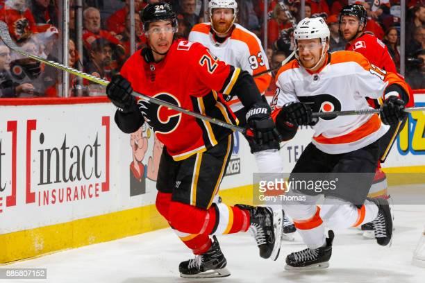 Michael Raffl of the Philadelphia Flyers follows Travis Hamonic of the Calgary Flames in a game against the Philadelphia Flyers at the Scotiabank...
