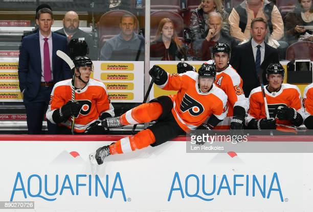 Michael Raffl of the Philadelphia Flyers jumps to the ice on a shift change with Jori Lehtera Valtteri Filppula Travis Konecny Assistant Coach Kris...