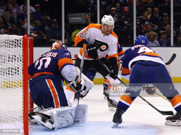 Michael Raffl of the Philadelphia Flyers moves in on Kristers Gudlevskis of the New York Islanders during the second period during a preseason game...
