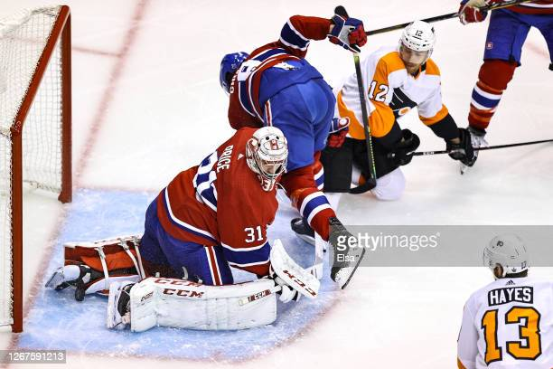 Michael Raffl of the Philadelphia Flyers scores a goal past Carey Price of the Montreal Canadiens at 4:26 during the second period in Game Six of the...