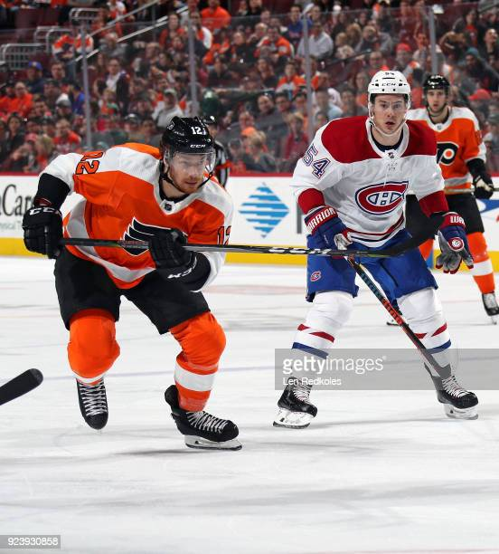 Michael Raffl of the Philadelphia Flyers skates against Charles Hudon of the Montreal Canadiens on February 20 2018 at the Wells Fargo Center in...