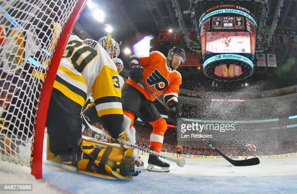 Michael Raffl of the Philadelphia Flyers skates through the crease on a scoring opportunity against Matthew Murray of the Pittsburgh Penguins in Game...