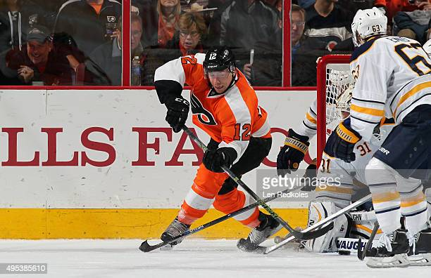 Michael Raffl of the Philadelphia Flyers takes a wraparound shot on goal against Chad Johnson of the Buffalo Sabres on October 27 2015 at the Wells...