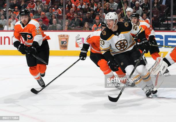 Michael Raffl Valtteri Filppula and Brandon Manning of the Philadelphia Flyers in action against Riley Nash of the Boston Bruins on December 2 2017...