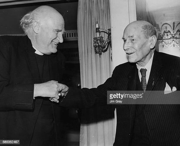 Michael Ramsey the Archbishop of Canterbury shaking hands with Lord Clement Attlee former British Prime Minister at a Foyles Literary Luncheon at the...