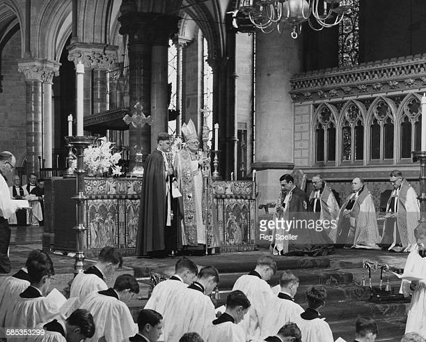 Michael Ramsey the Archbishop of Canterbury speaking a blessing on the High Altar at Canterbury Cathedral June 17th 1961