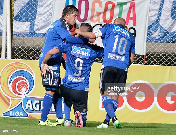 Michael Rangel of Millonarios celebrates with teammates after scoring the second goal of his team during a match between Patriotas FC and Millonarios...