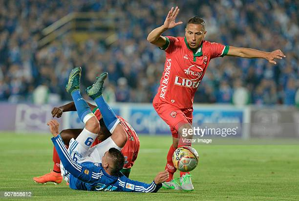 Michael Rangel of Millonarios fights for the ball with Anderson Zapata of Patriotas FC during a match between Millonarios and Patriotas FC as part of...