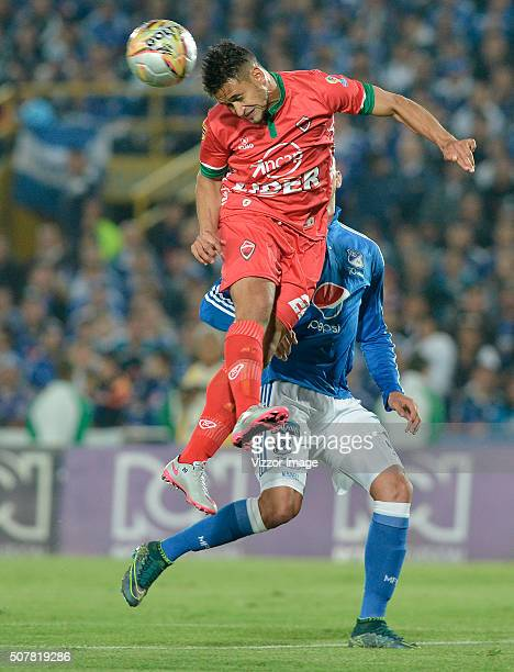 Michael Rangel of Millonarios fights for the ball with Jhon Cano of Patriotas FC during a match between Millonarios and Patriotas FC as part of the...