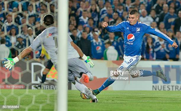 Michael Rangel of Millonarios fights for the ball with Juan Castillo goalkeeper of Patriotas FC during a match between Millonarios and Patriotas FC...