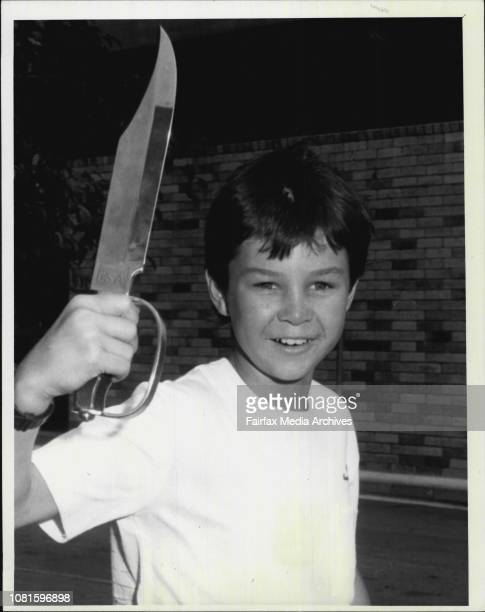 Michael Rankin of Grays Point holds one of the crocodile Dundee style bowie knives available from disposal stores for $155 June 18 1987