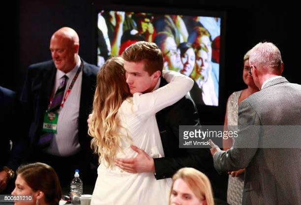 Michael Rasmussen ninth overall pick of the Detroit Red Wings celebrates with his family during Round One of the 2017 NHL Draft at United Center on...