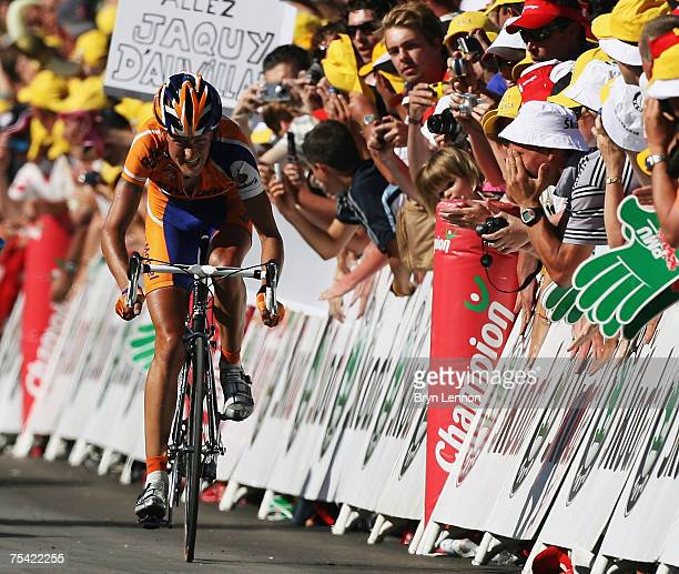 Michael Rasmussen of Denmark and Rabobank approaches the finish line to win stage 8 of the 2007 Tour de France from Le Grand-Bounand to Tignes on...