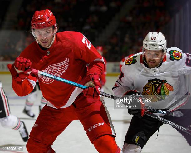 Michael Rasmussen of the Detroit Red Wings battles for position with Jacob Nilsson of the Chicago Blackhawks during a pre-season NHL game at Little...
