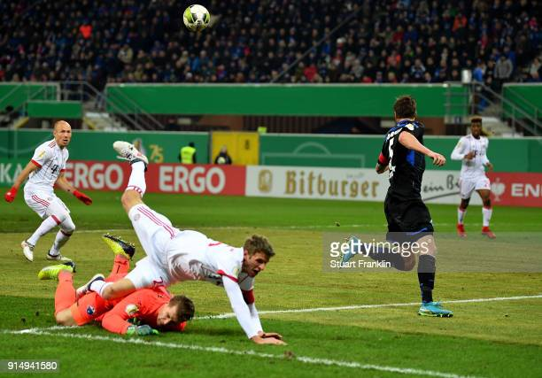 Michael Ratajczak goalkeeper of Paderborn tackles Thomas Mueller of Muenchen during the DFB Cup quarter final match between SC Paderborn and Bayern...