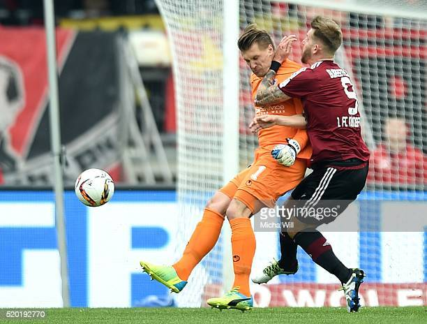 Michael Ratajczak of Duisburg and Guido Burgstaller of Nuernberg clash during the Second Bundesliga match between 1 FC Nuernberg and MSV Duisburg at...