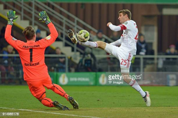 Michael Ratajczak of Paderborn and Thomas Mueller of Bayern Muenchen battle for the ball during the DFB Cup match between SC Paderborn and Bayern...