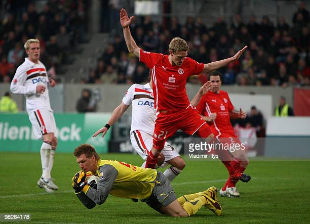 Michael Ratajczak saves the ball as his team mate Johannes van den Bergh of Fortuna defends during the Second Bundesliga match between Fortuna...