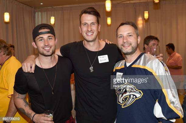 Michael Ray Russell Dickerson and Brandon Heath attend the 25th Annual CAA BBQ in Nashville at CAA Nashville on June 5 2017 in Nashville Tennessee