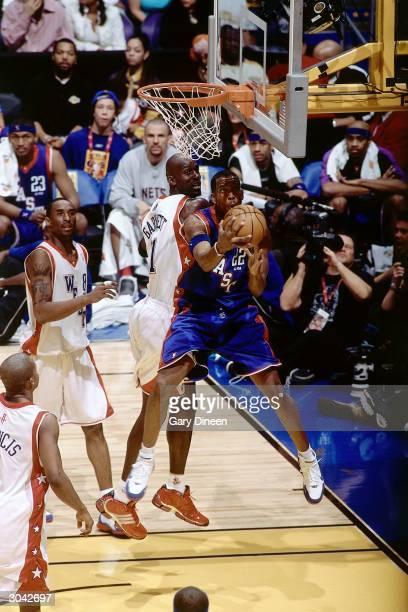 Michael Redd of the Eastern Conference AllStars shoots against Kevin Garnett of the Western Conference AllStars during the 2004 AllStar Game on...