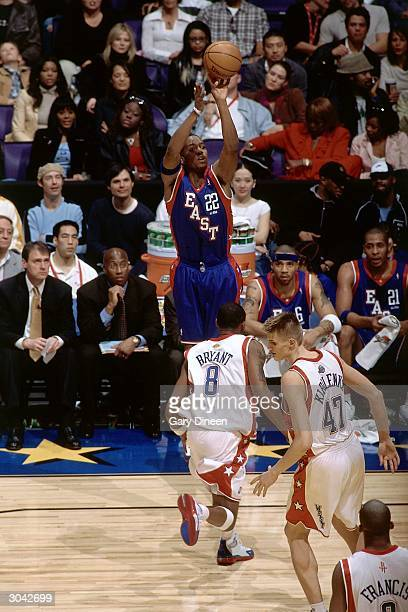 Michael Redd of the Eastern Conference AllStars shoots against Kobe Bryant of the Western Conference AllStars during the 2004 AllStar Game on...