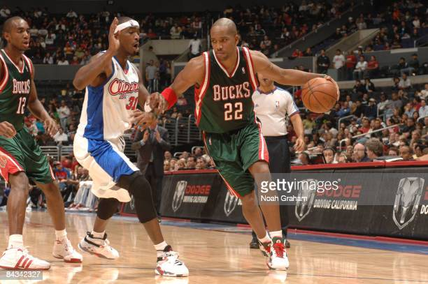 Michael Redd of the Milwaukee Bucks dribbles against Ricky Davis of the Los Angeles Clippers at Staples Center on January 17 2009 in Los Angeles...