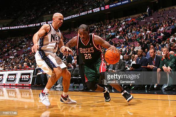 Michael Redd of the Milwaukee Bucks drives against Jason Kidd of the New Jersey Nets on November 15 2006 at Continental Airlines Arena in East...