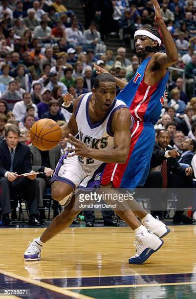 Michael Redd of the Milwaukee Bucks drives around Richard Hamilton of the Detroit Pistons in Game three of the Eastern Conference Quarterfinals...