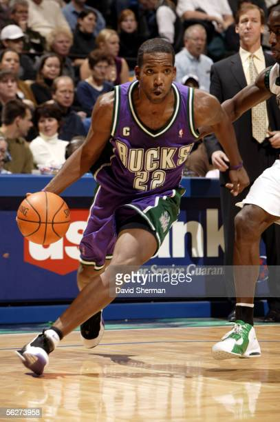 Michael Redd of the Milwaukee Bucks drives to the basket against the Minnesota Timberwolves on November 25 2005 at the Target Center in Minneapolis...