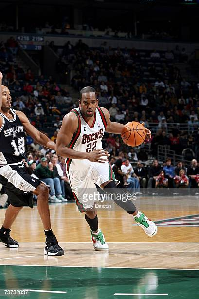Michael Redd of the Milwaukee Bucks drives to the paint around Bruce Bowen of the San Antonio Spurs at Bradley Center on March 15 2007 in Milwaukee...