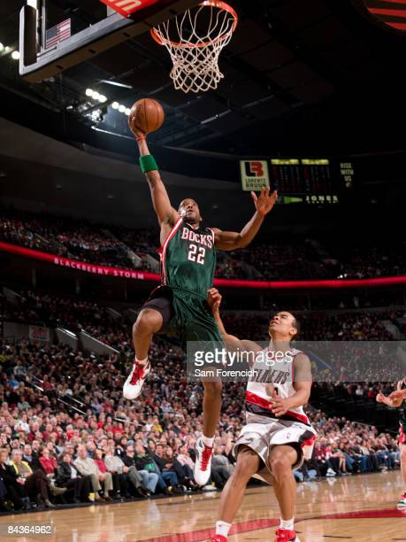 Michael Redd of the Milwaukee Bucks goes up for a shot past Jerryd Bayless of the Portland Trail Blazers during a game on January 19, 2009 at the...