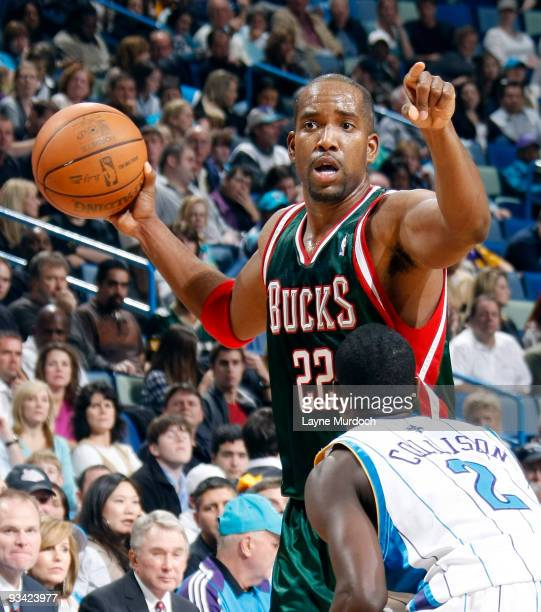 Michael Redd of the Milwaukee Bucks keeps the ball away from Darren Collison of the New Orleans Hornets on November 25 2009 at the New Orleans Arena...
