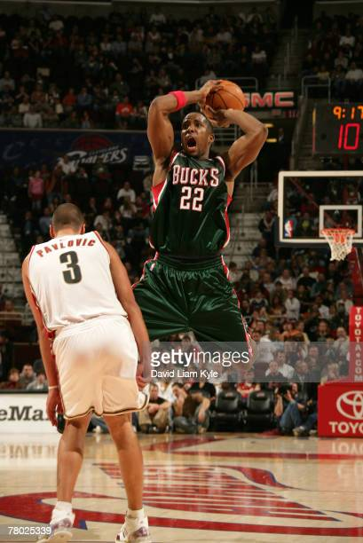 Michael Redd of the Milwaukee Bucks looks to pass after trying to draw the foul against Sasha Pavlovic of the Cleveland Cavaliers on November 20,...