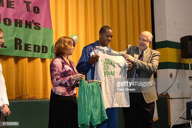 Michael Redd of the Milwaukee Bucks receives a t shirt and shorts as a gift following his presentation to students during the Healthy Kids Wellness...