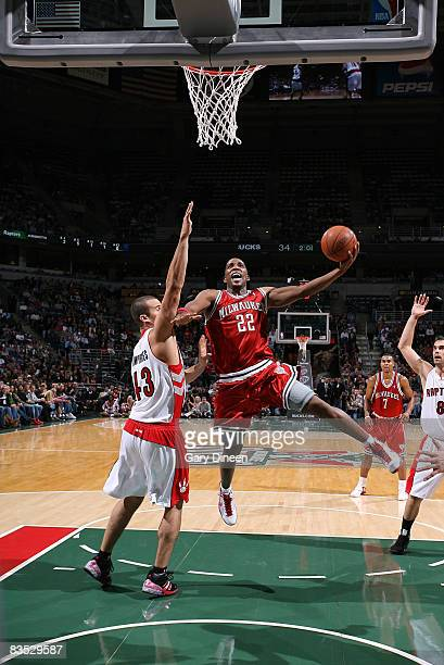 Michael Redd of the Milwaukee Bucks shoots a layup against Kris Humphries of the Toronto Raptors on November 1 2008 at the Bradley Center in...